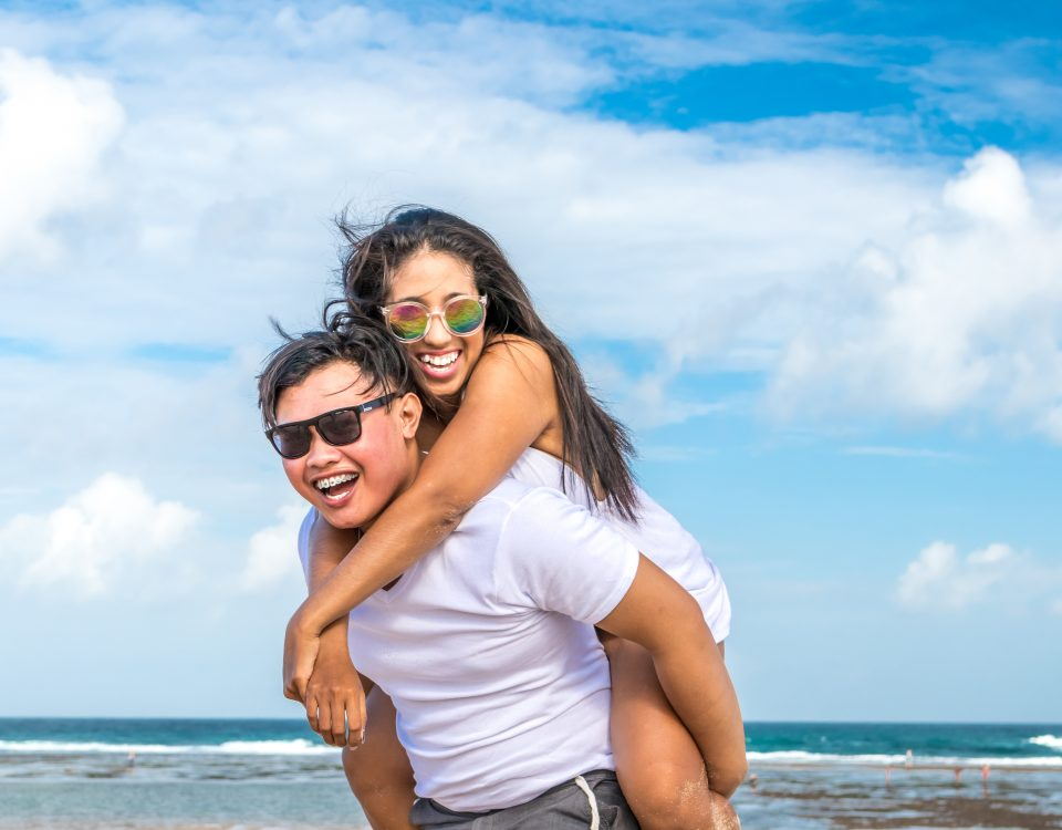 Asian couple on the beach of tropical Bali island.